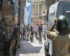 Two dozen security men, protestors injured in Kashmir