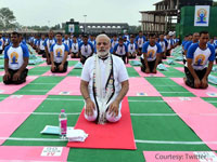 Yoga no religious activity, a global mass movement: Modi