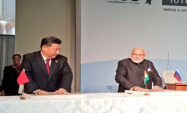 China, India pledge to step up military exchanges