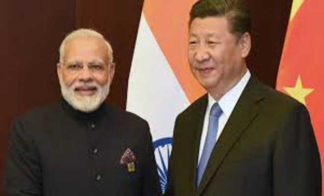 China says ties with India developing with 'sound momentum'