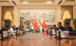 Modi meets Xi, invites him to India in 2019