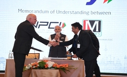 Modi launches RuPay card in UAE, buys 1 kg laddoos