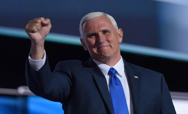 Pence takes on mantle of prime campaigner with Trump still hospitalised